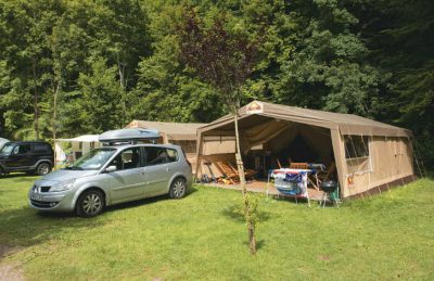 Family staying at one of the Eurocamp Safari Tents