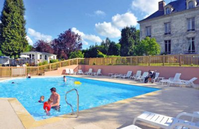 The swimming pool is next to the Chateau on the campsite